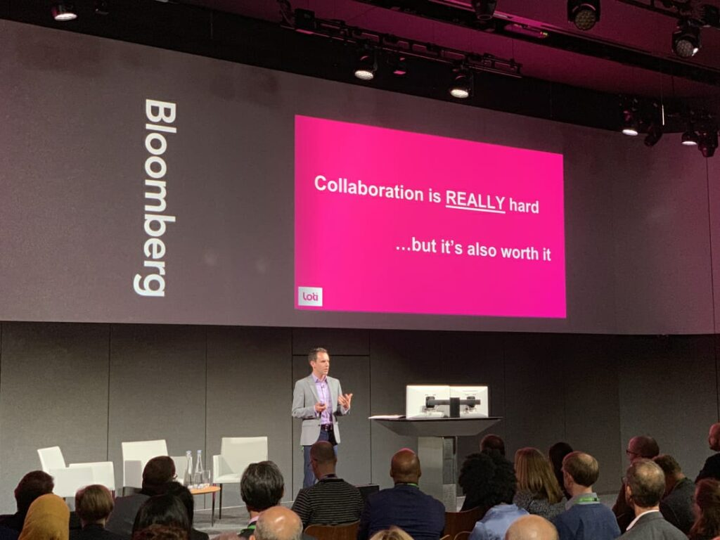 Eddie Copeland sharing a slide saying Collaboration is really hard but it's worth it